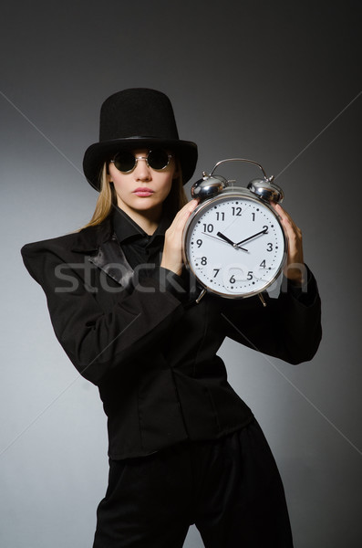 Woman with clock in business concept Stock photo © Elnur