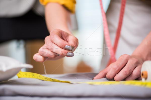 Terzi eller çalışma yeni giyim iş Stok fotoğraf © Elnur