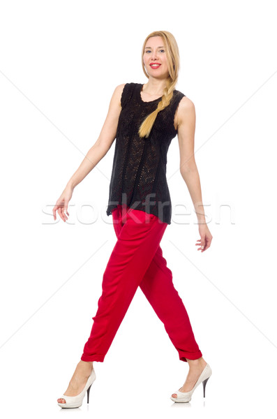 Tall young woman in red pants isolated on white Stock photo © Elnur