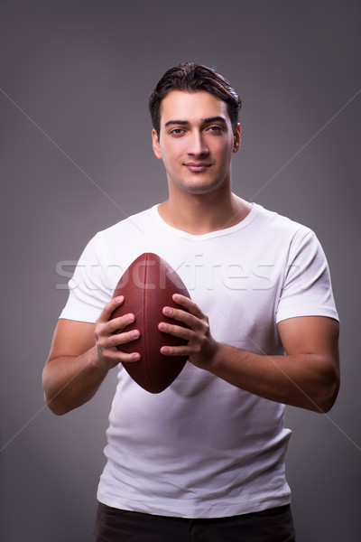 Man with american football in sports concept Stock photo © Elnur