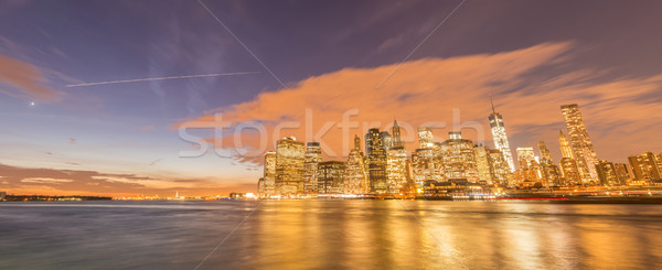 Kilátás alsó Manhattan üzlet alma éjszaka Stock fotó © Elnur