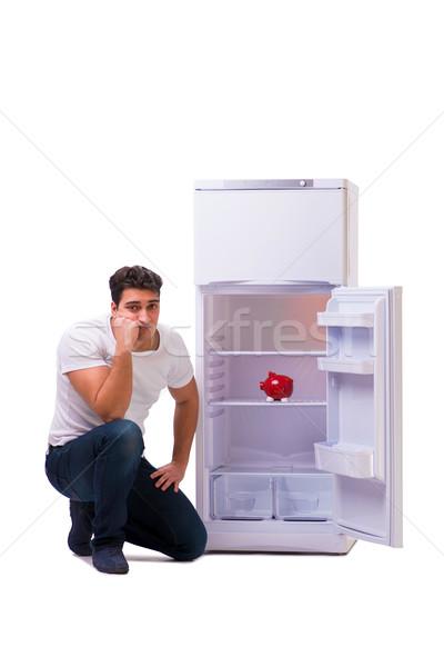 Сток-фото: голодный · человека · глядя · деньги · холодильник · продовольствие