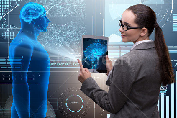 Futuristic remote diagnostics concept with businesswoman Stock photo © Elnur