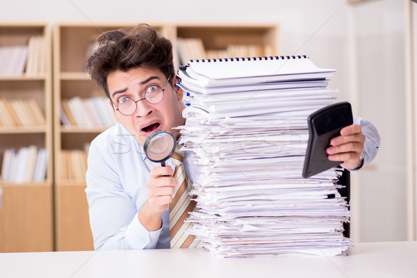 Mad auditor looking for errors in the report Stock photo © Elnur