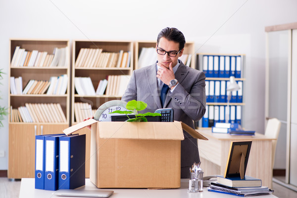 Young businessman moving offices after being made redundant Stock photo © Elnur