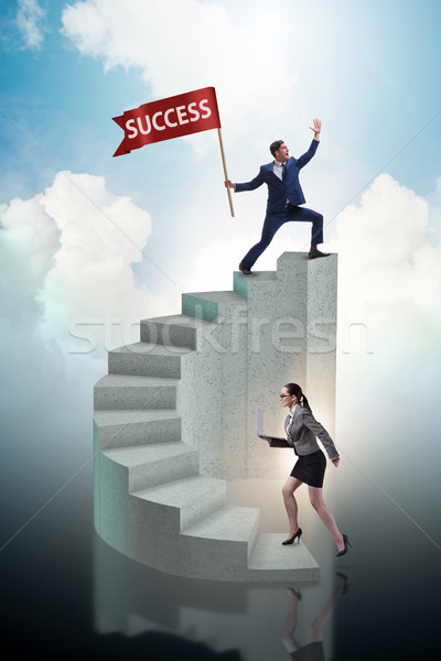 The businessman with success banner in business concept Stock photo © Elnur