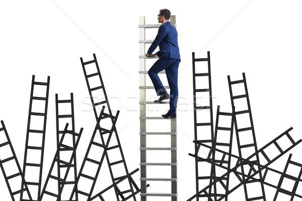 Career concept with businessman climbing ladder Stock photo © Elnur