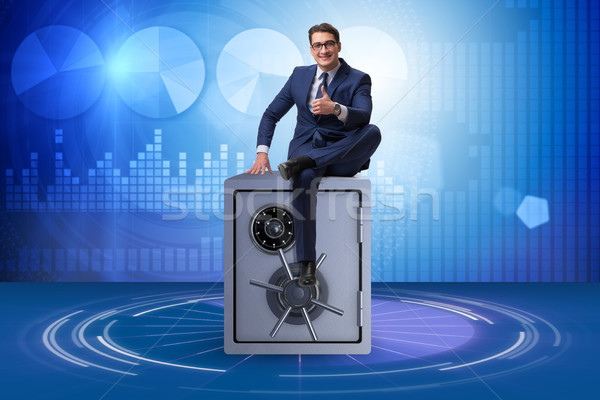 Businessman sitting on top of safe Stock photo © Elnur