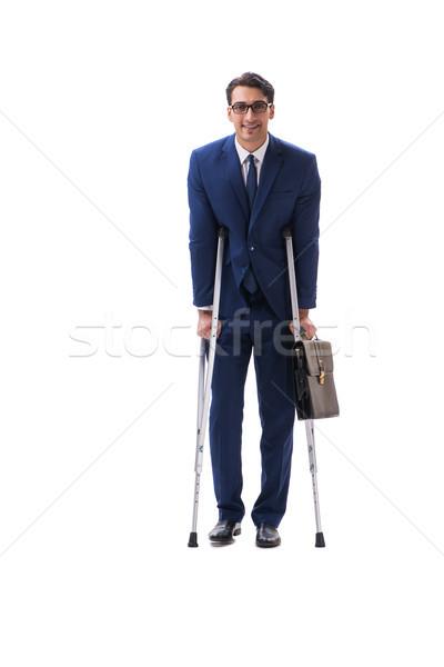 üzletember sétál mankók izolált fehér férfi Stock fotó © Elnur