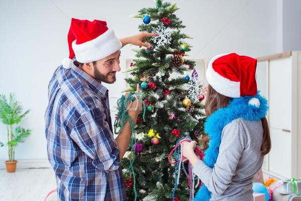 молодые семьи рождественская елка счастливым случай женщину Сток-фото © Elnur