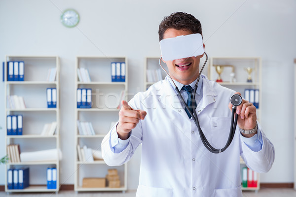 Young doctor with vr virtual reality headset working in the offi Stock photo © Elnur