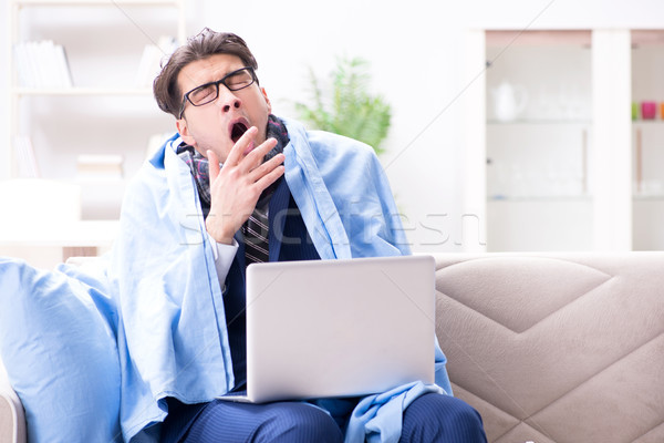 Sick businessman working from home due to flu sickness Stock photo © Elnur