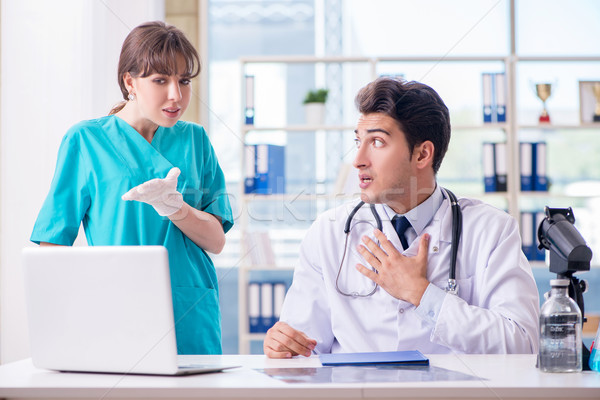 Doctor angry at his assistant due to medical error Stock photo © Elnur