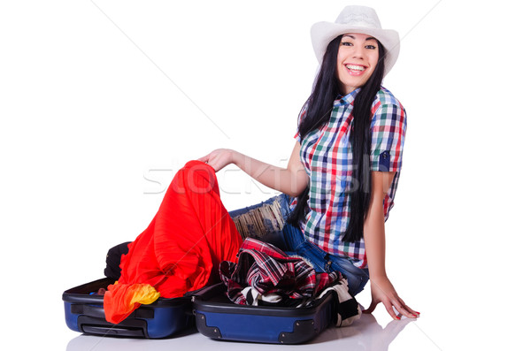 Woman with too much stuff in her case Stock photo © Elnur
