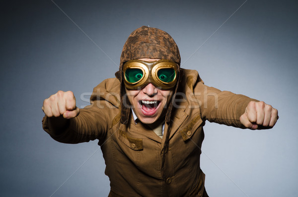 Funny pilot with goggles and helmet Stock photo © Elnur
