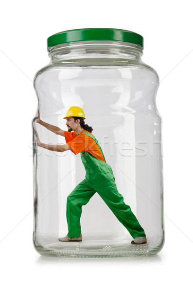 Man in coveralls imprisoned in glass jar Stock photo © Elnur