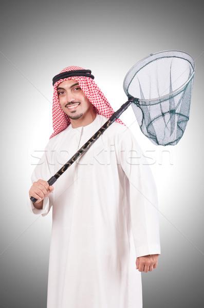 Arab businessman with catching net on white Stock photo © Elnur