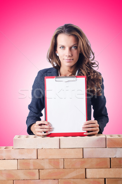 Woman builder and brick wall Stock photo © Elnur