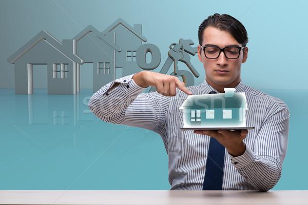 小さな ハンサム ビジネスマン 住宅ローン ビジネス オフィス ストックフォト © Elnur
