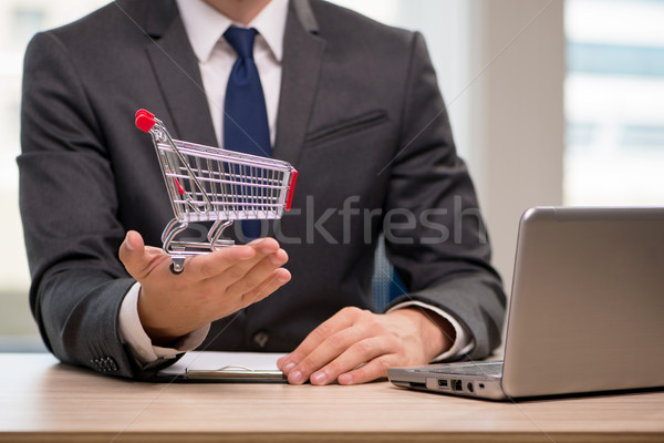 The businesswoman with shopping cart trolley Stock photo © Elnur