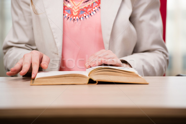 Young student reading book in preparation for exams Stock photo © Elnur