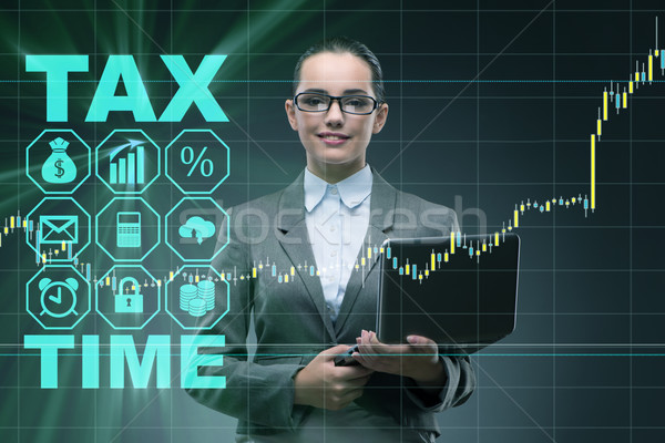 Businesswoman in business tax concept Stock photo © Elnur