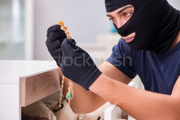 Robber wearing balaclava stealing valuable things Stock photo © Elnur