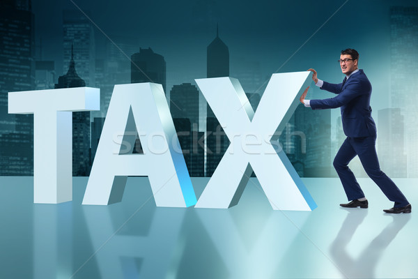 Businessman in high taxes concept Stock photo © Elnur