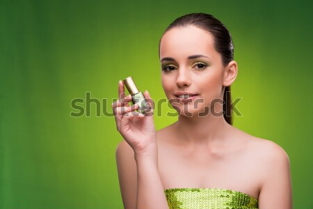 Stock photo: Beautiful woman applying make-up in beauty concept