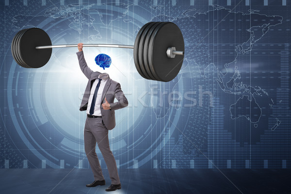 Concept with brain man and dumbbell Stock photo © Elnur