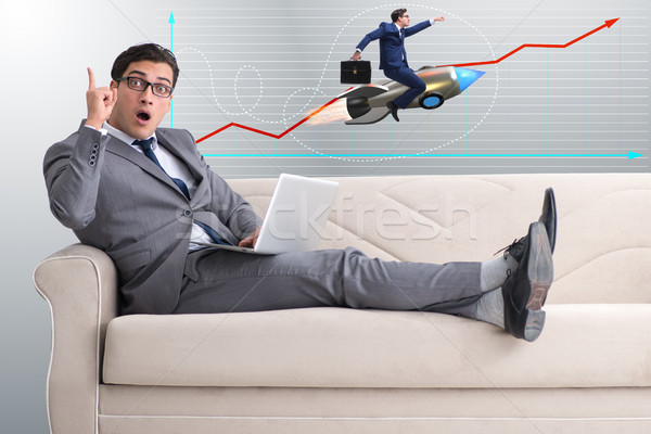 Businessman on rocket in trading concept Stock photo © Elnur