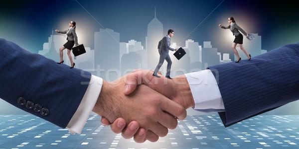 Cooperação pessoas corrida aperto de mão negócio homem Foto stock © Elnur