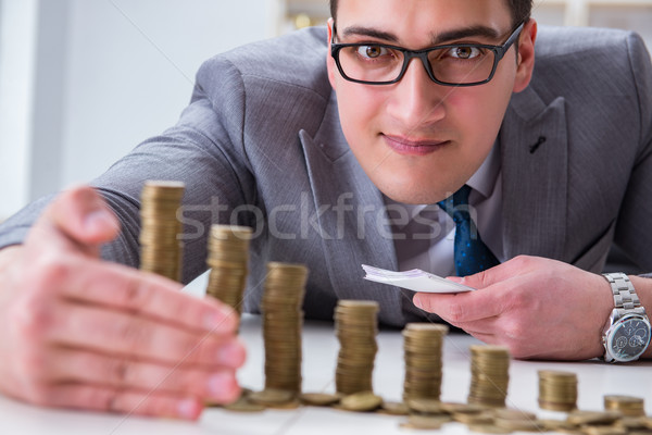 The businessman with golden coins in business growth concept Stock photo © Elnur