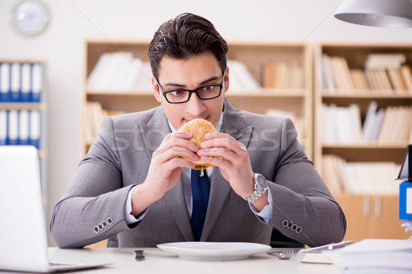 The hungry funny businessman eating junk food sandwich Stock photo © Elnur