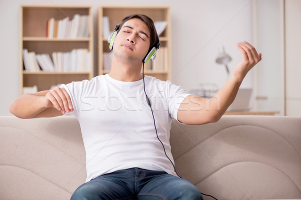 Man listening to music at home Stock photo © Elnur