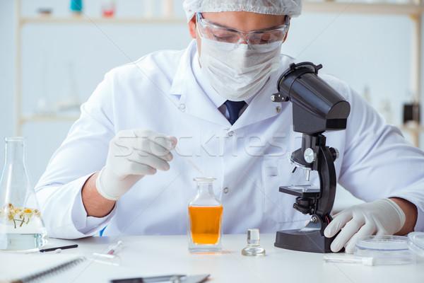 химик лаборатория цветок человека бутылку женщины Сток-фото © Elnur