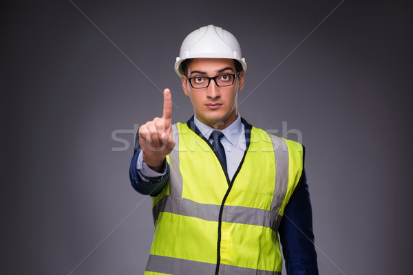 Man wearing hard hat and construction vest Stock photo © Elnur