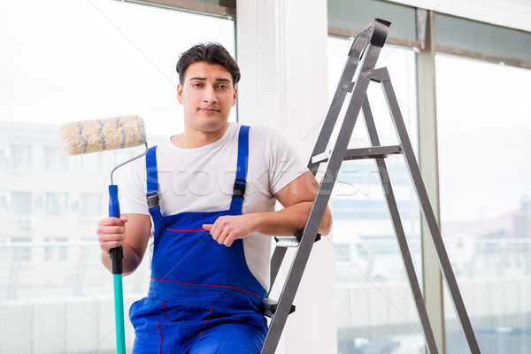 Painter repairman working at construction site Stock photo © Elnur