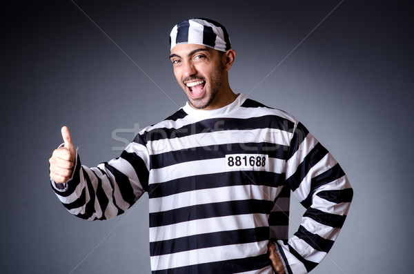 Convict criminal in striped uniform Stock photo © Elnur