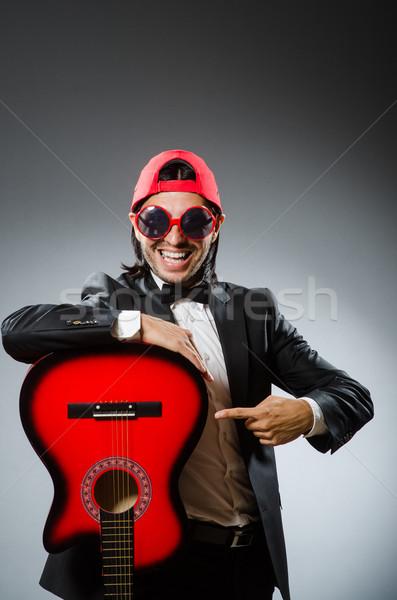 Funny guitar player in studio Stock photo © Elnur