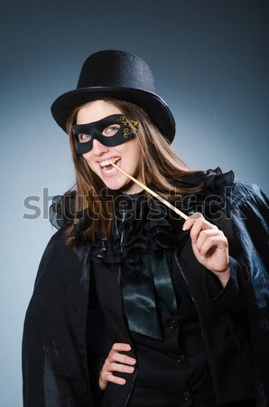 Mujer arma negro cuero traje nina Foto stock © Elnur