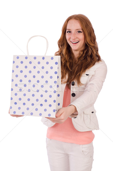 Cute smiling girl in light short coat with plastic bags isolated on white Stock photo © Elnur