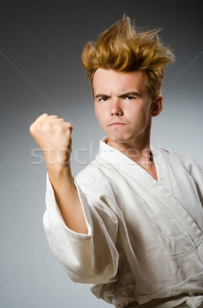 Funny karate fighter wearing white kimono Stock photo © Elnur