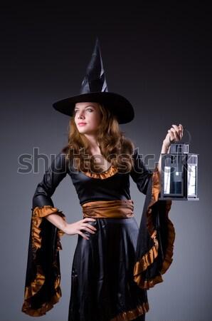 Witch with book in dark studio Stock photo © Elnur