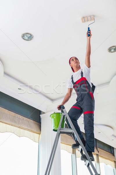 Fiatal festő festmény plafon építkezés fal Stock fotó © Elnur