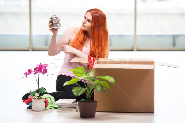 Fiatal nő költözés életstílus nő ház otthon Stock fotó © Elnur