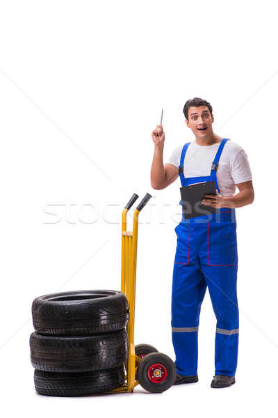 The tyre repairman with trolley isolated on white Stock photo © Elnur