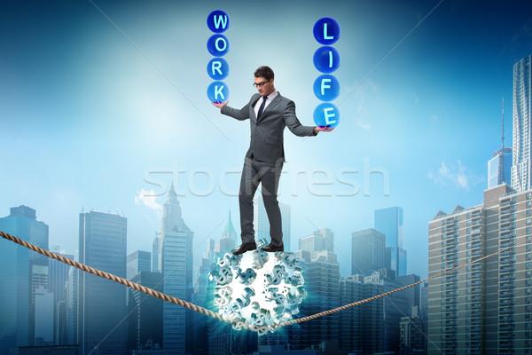 Businessman in work home balance concept Stock photo © Elnur