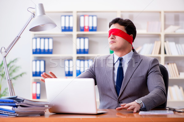 Blindfold businessman sitting at desk in office Stock photo © Elnur