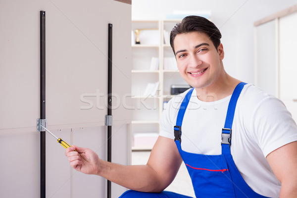The furniture repair and assembly concept Stock photo © Elnur